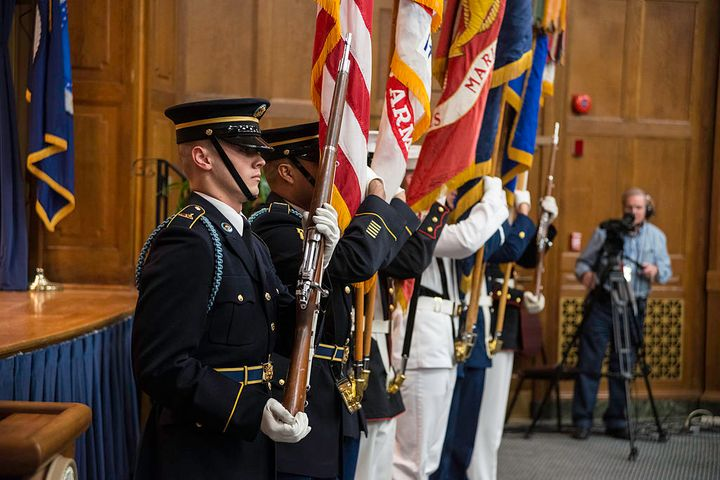 The U.S. Military District of Washington Joint Armed Forces Color Guard presents the colors at an LGBT Pride Observance