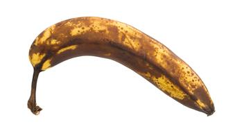 Over ripe banana, isolated on white background