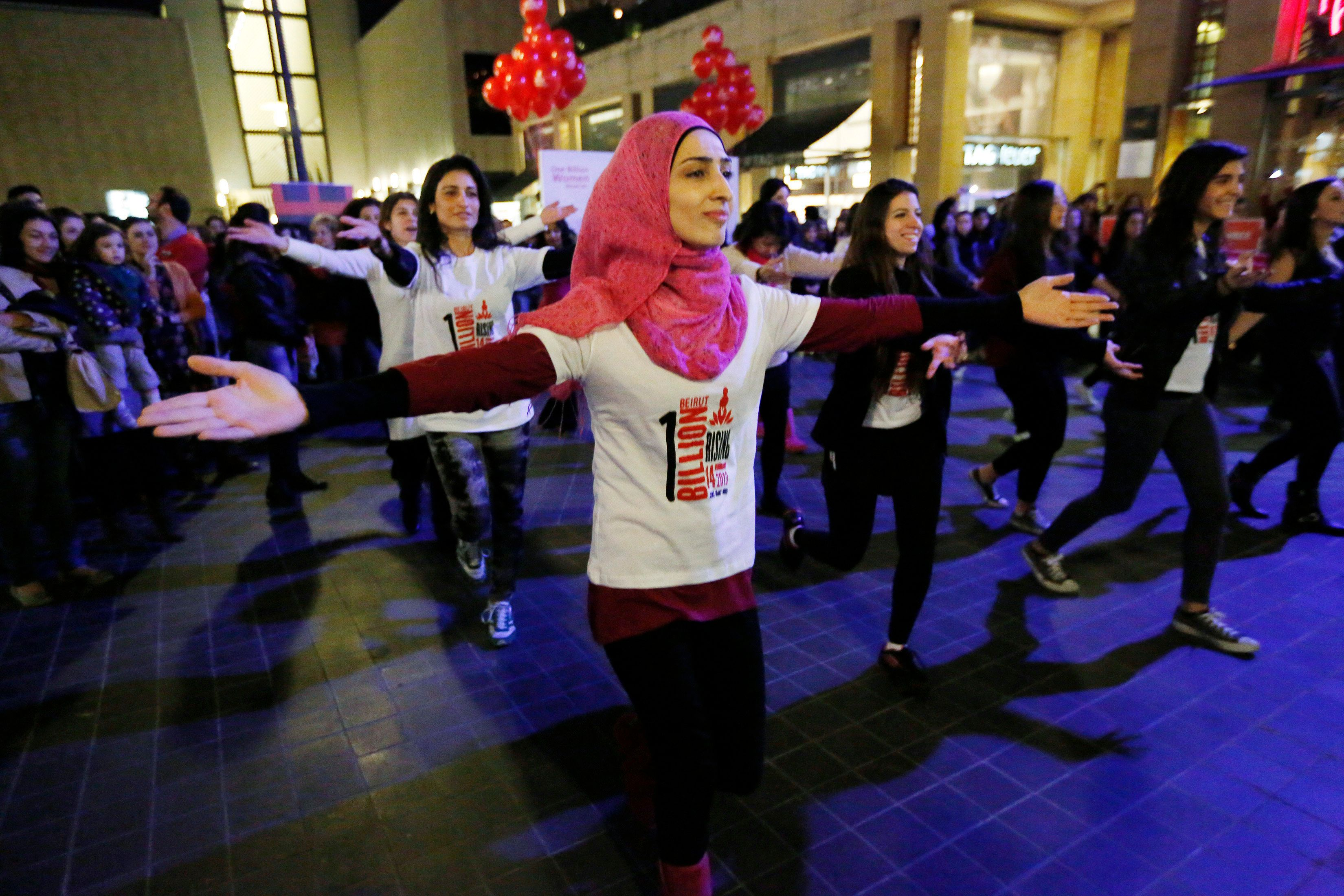 """Women dance to the theme song of the """"One Billion Rising"""" campaign in Beirut February 14, 2013. """"One Billion Rising"""" is a campaign aimed to call an end to violence against women and girls, according to the organisers. REUTERS/Jamal Saidi       (LEBANON - Tags: CIVIL UNREST SOCIETY)"""