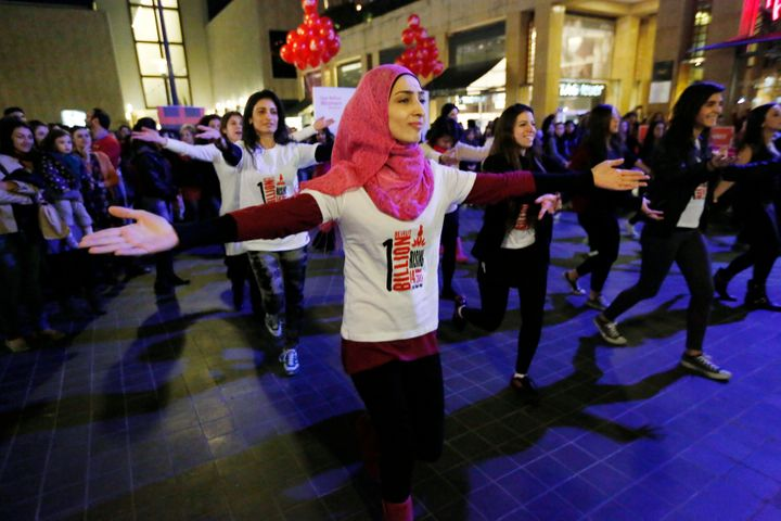 "Women dance to the theme song of the ""One Billion Rising"" campaign in Beirut February 14, 2013."
