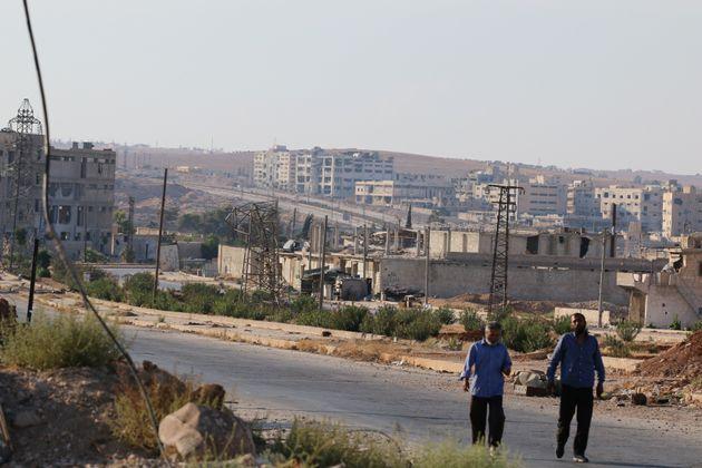 Abdalrhman Ismail  Reuters People walk near Castello road in Aleppo Syria
