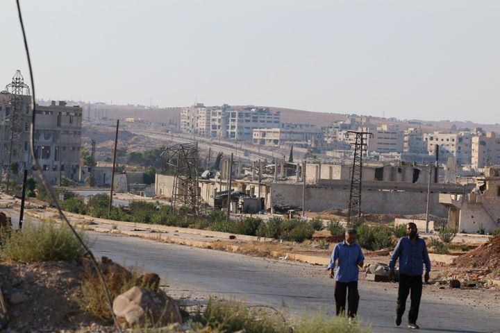 People walk near Castello road (background) in Aleppo, Syria, September 14, 2016.