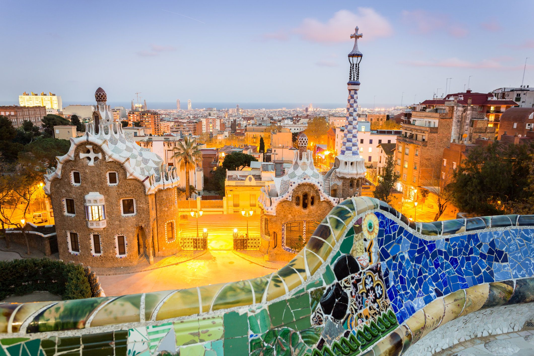Sunset over the amazing Park Guell in Barcelona, stunning park designed by Antonio Gaudi. Benches with the Trencadis Tecnique. That's one of the most visited and famous attractions in the Spanish city.