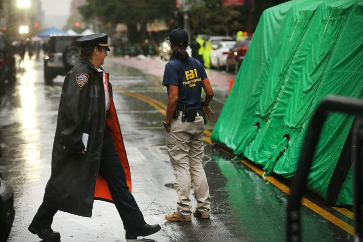 Police and FBI members search around the scene of a bombing in the Chelsea neighborhood of Manhattan on September 19, 2016 in New York City.