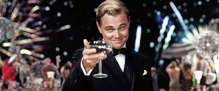"Leonardo DiCaprio as Jay Gatsby in the 2013 movie, <a href=""https://www.youtube.com/watch?v=rARN6agiW7o"" target=""_blank"">""The"
