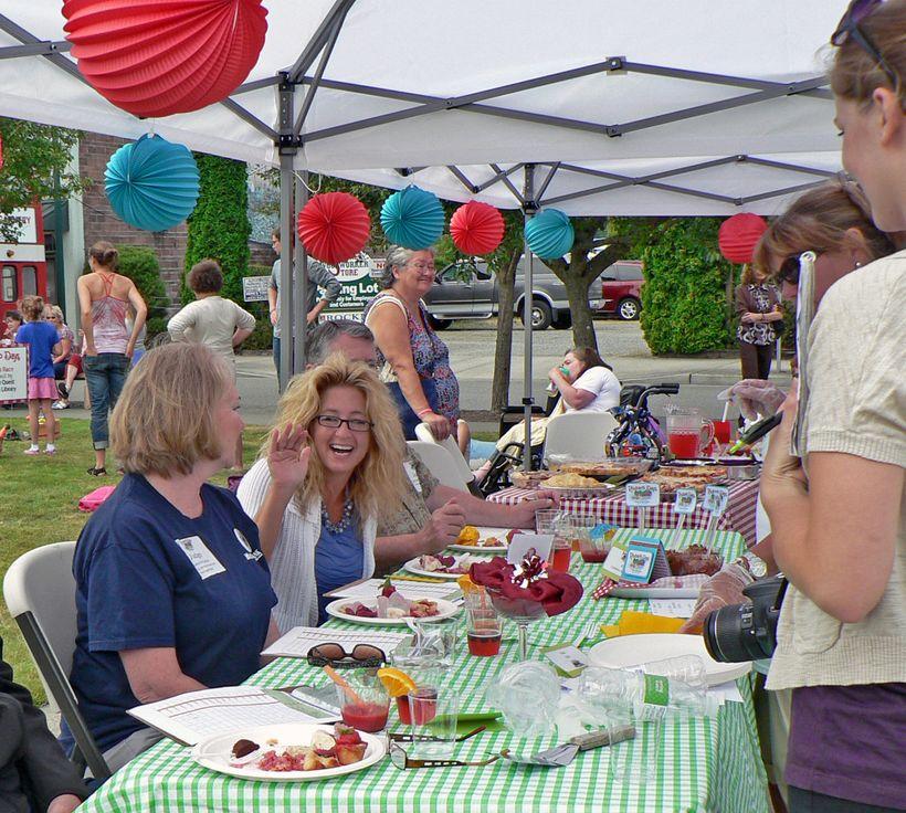 Judges enjoying Sumner's annual Rhubarb Pie Festival