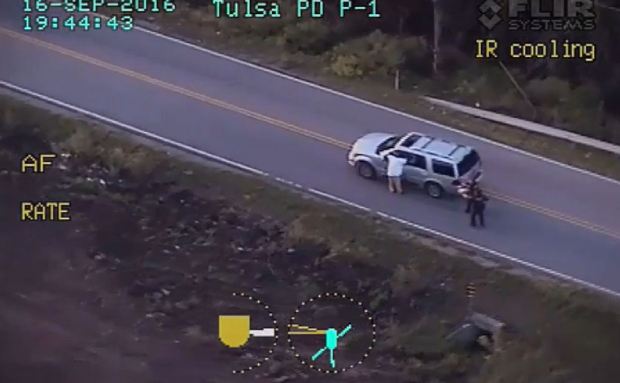 In this photo taken from video footage released Monday by the Tulsa Police Department, Terence Crutcher, left, appears s