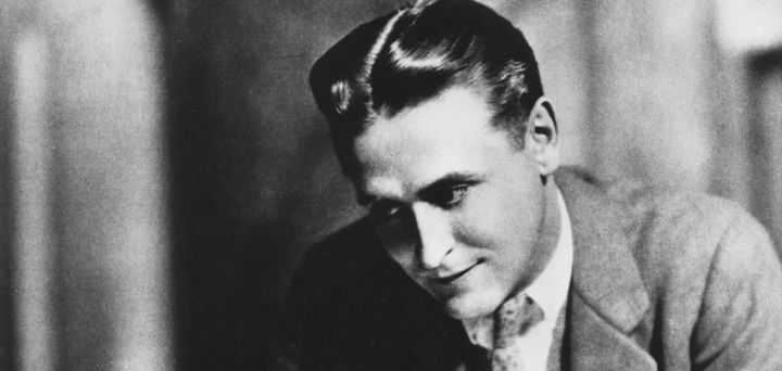 F. Scott Fitzgerald with slicked back hair and what looks to be a middle part.
