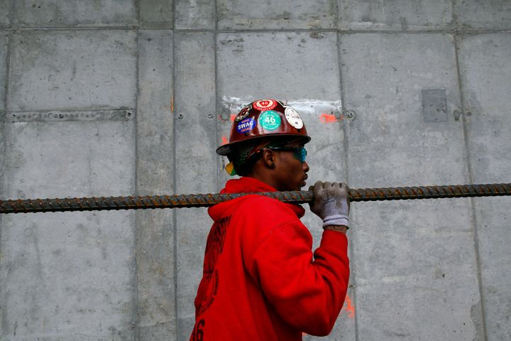 A worker carries a piece of rebar at the World Trade Center transportation hub in New York, May 6, 2013.