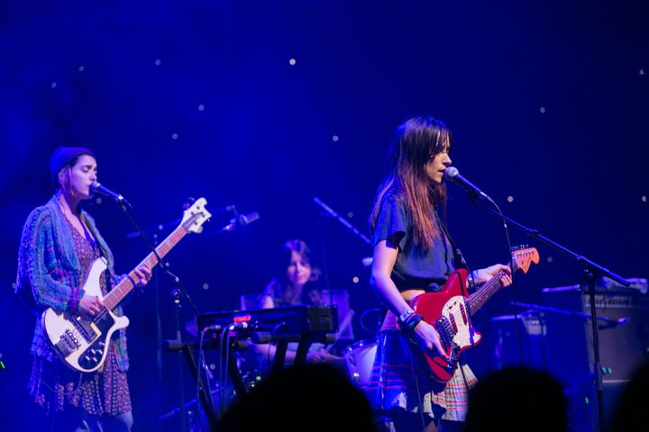 Jenny Lee Lindberg, Stella Mozgawa and Theresa Wayman of Warpaint perform on Aug. 23 in Dublin, Ireland.