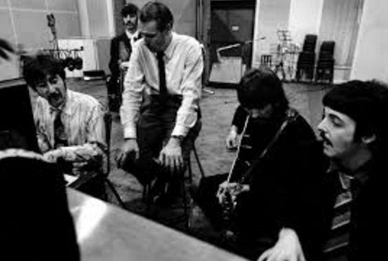 The Beatles at work in Abbey Road Studios with their musical mentor George