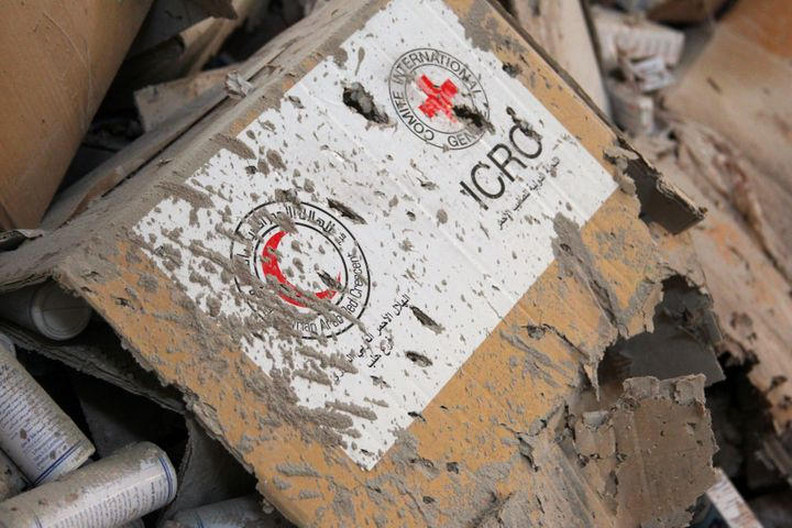 Damaged Red Cross and Red Crescent medical supplies lie inside a warehouse after an airstrike on the rebel held Urm al-Kubra