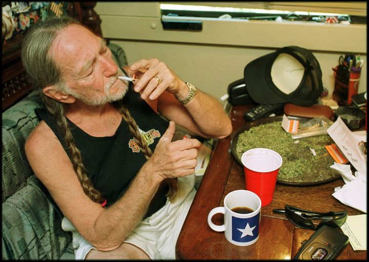"""The """"Roll Me Up and Smoke Me When I Die"""" singer, seen herein front of a spread of pot, launched his own mar"""
