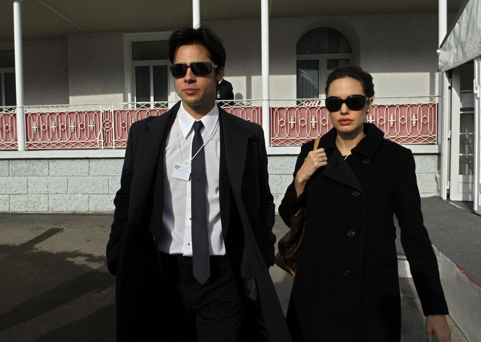 Angelina Jolie and Brad Pitt leave Hotel Belvedere in Davos, Switzerland, on Jan. 26, 2006. UN goodwill ambassador Angelina J