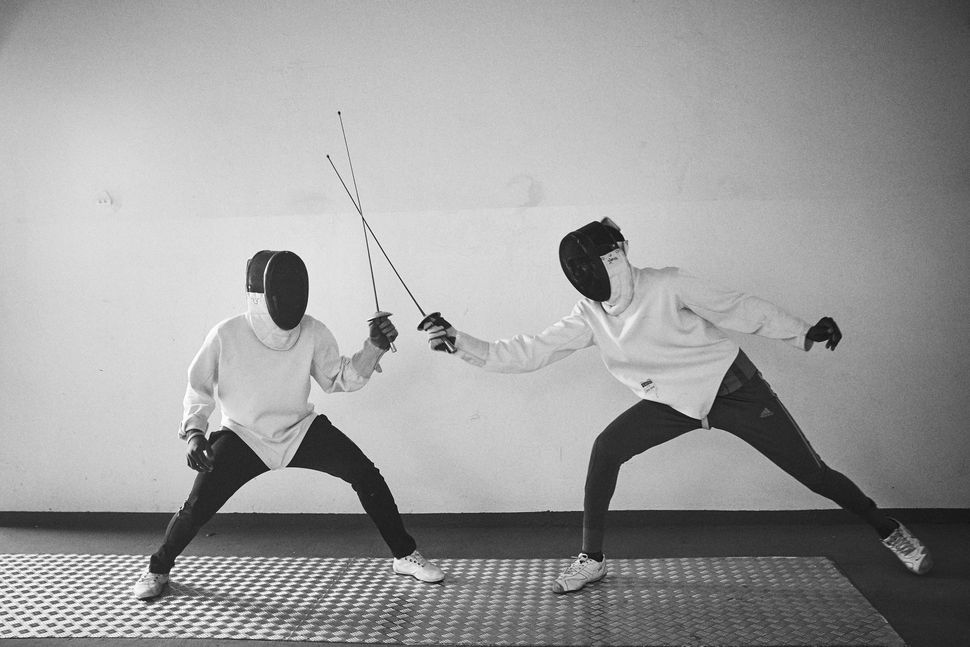 Minors incarcerated at a nearby prison participate in a match during a fencing session at a studio in the city of Thiè
