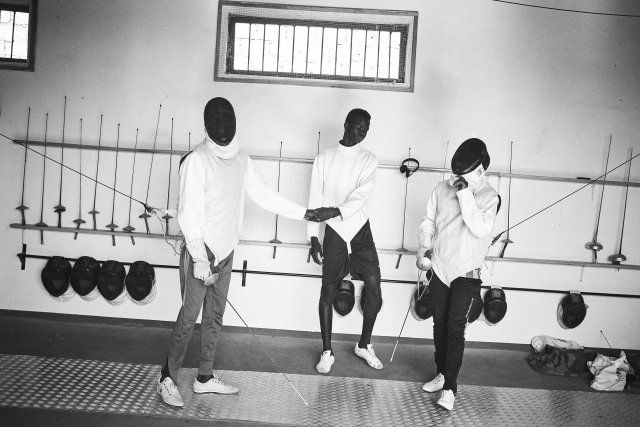 Minors incarcerated at a nearby prison participate in a fencing session at a studio in the city.