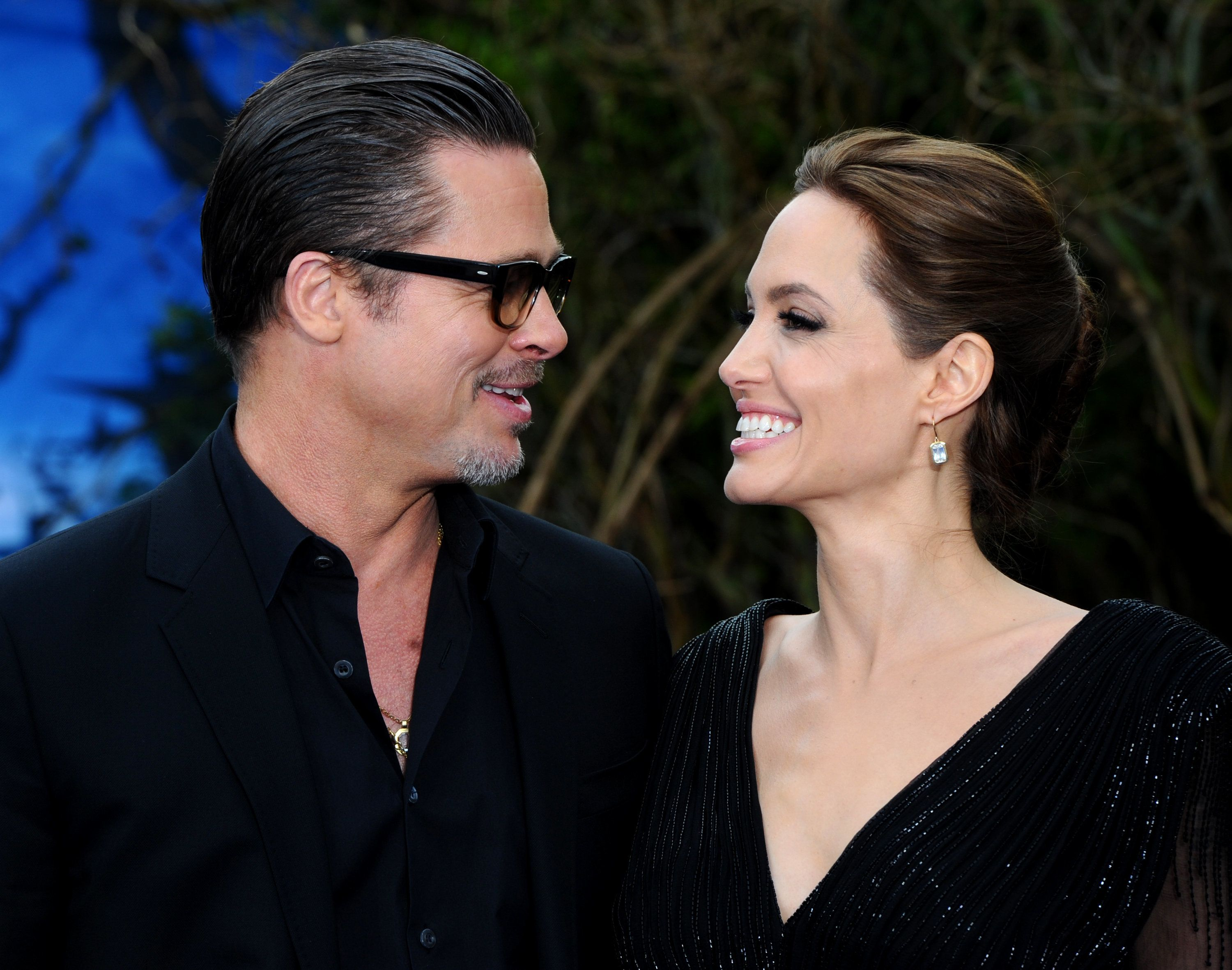 Brad Pitt and Angelina Jolie attend a private reception as costumes and props from Disney's 'Maleficent'...
