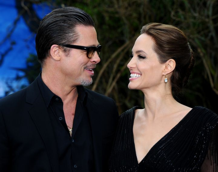 Brad Pitt and Angelina Jolie attend a private reception as costumes and props from Disney's 'Maleficent' are exhibited in sup