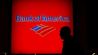 The silhouette of a pedestrian is seen walking past a Bank of America Corp. branch at night in New York, U.S., on Saturday, April 11, 2015. Bank of America Corp. is scheduled to release earnings figures on April 15. Photographer: Craig Warga/Bloomberg via Getty Images