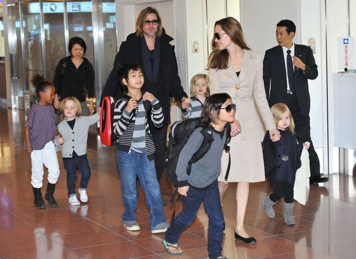 Brad Pitt, Angelina Jolie and their six children Maddox, Pax, Zahara, Shiloh, Knox, and Vivienne arrive at Haneda Internation