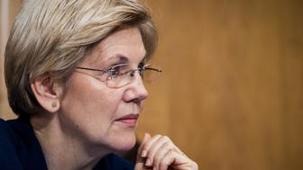 Senator Elizabeth Warren, a Democrat from Massachusetts, listens as John Stumpf, chief executive officer of Wells Fargo & Co., not pictured, testifies in front of the Senate Committee on Banking, Housing, and Urban Affairs in Washington, D.C., U.S., on Tuesday, Sept. 20, 2016. Stumpf, struggling to quell public rancor after the bank's employees opened unauthorized accounts for legions of customers, said the company has expanded its review of the matter to include 2009 and 2010. Photographer: Pete Marovich/Bloomberg via Getty Images