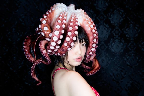Namada and Yamamoto boiled the octopus and turned it into a hat for one last photo before eating their collaborator.