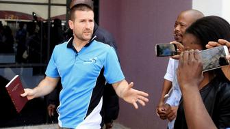 Controversial US Pastor Steven Anderson reacts as he leaves the Botswana Department of immigration after being issued a deportation order by Botswana authorities, on September 20, 2016, in Gaborone. Botswana on September 20, 2016 said it would deport the Holocaust-denying, anti-gay pastor, declaring him a 'prohibited immigrant'. Anderson, who in 2009 infamously prayed for US President Barack Obama's death, was arrested by immigration officials shortly after being interviewed on a popular radio station. / AFP / Stringer / Botswana OUT        (Photo credit should read STRINGER/AFP/Getty Images)