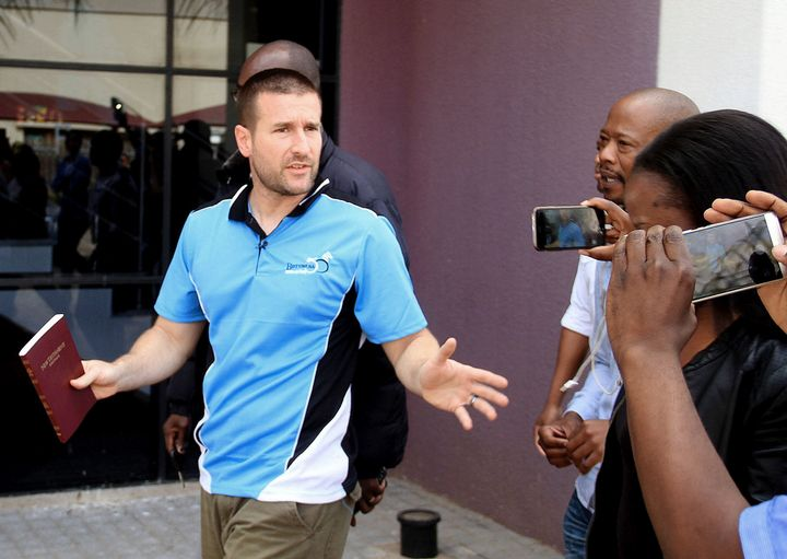 Controversial U.S. Pastor Steven Anderson reacts as he leaves the Botswana Department of immigration on Sept. 20.