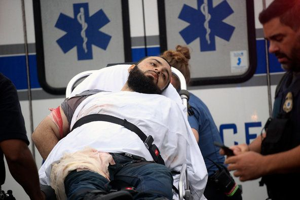 Ahmad Khan Rahami being placed into an ambulance after a gunfight with police that left one officer injured.