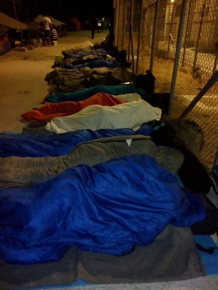Refugees and migrants in sleeping bags outside of Moria after a blaze destroyed much of the camp.