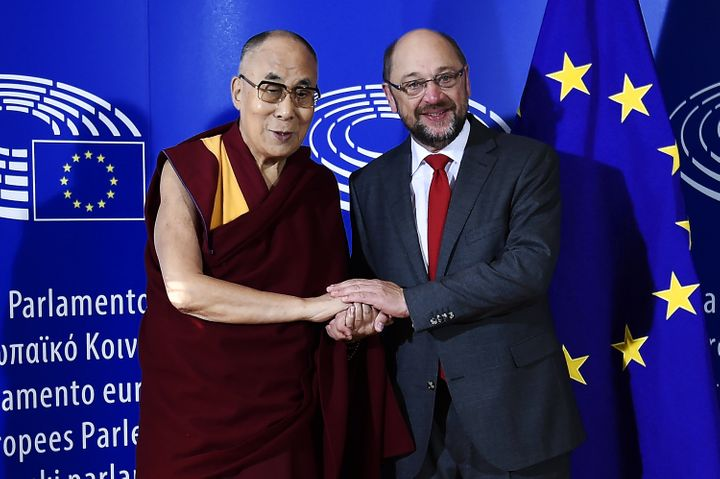 The Dalai Lama (L) is welcomed by European Parliament President Martin Schulz as part of his visit at the European Parliament