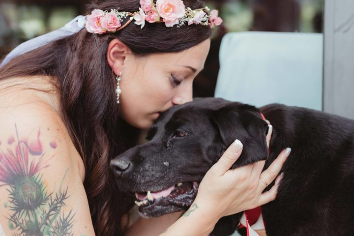 Bride Kelly O'Connell and her beloved pooch Charlie Bear share a moment on her wedding day.