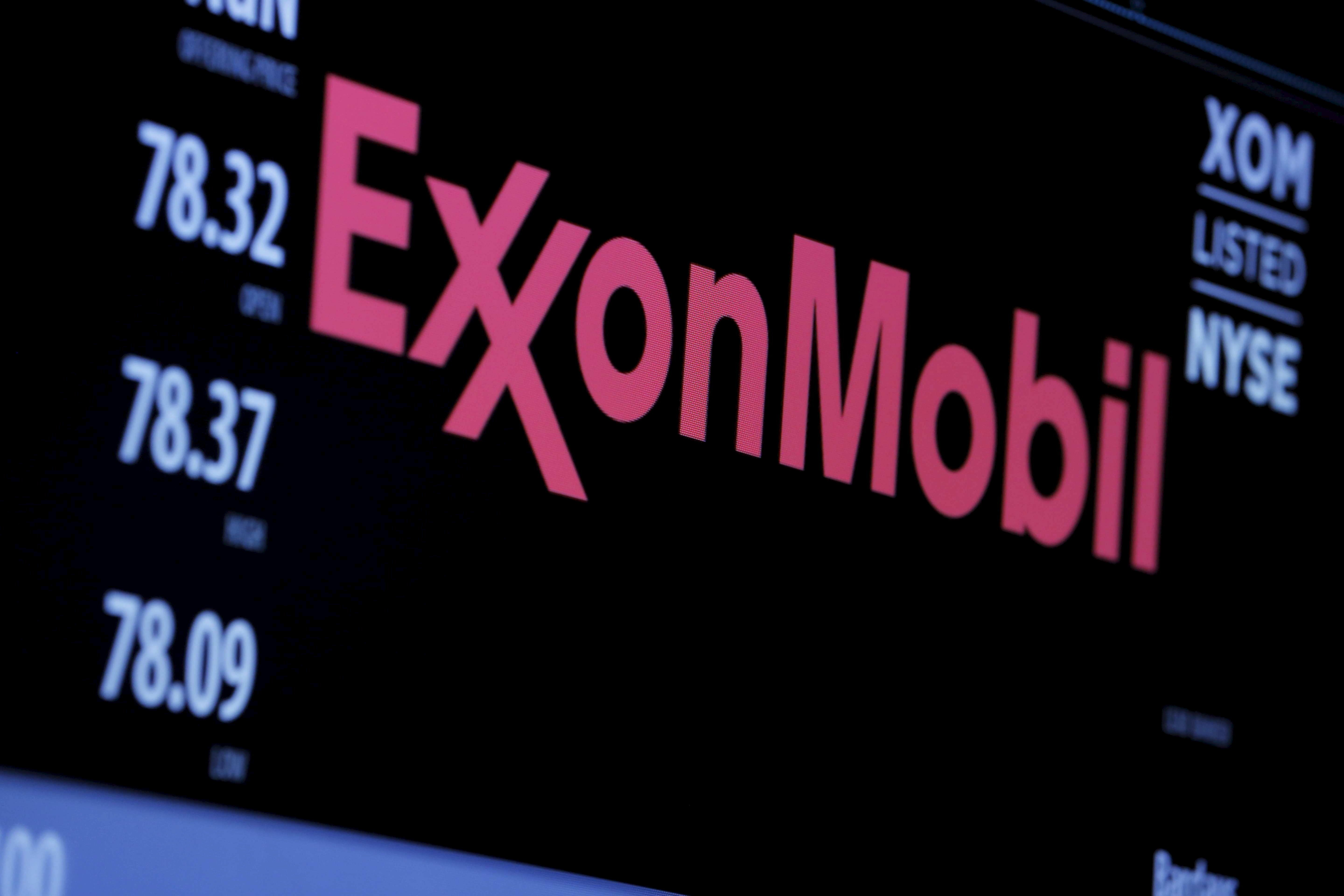 The logo of Exxon Mobil Corporation is shown on a monitor above the floor of the New York Stock Exchange in New York, New Yor