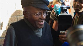 South African anti-apartheid activist and Nobel Peace Laureate Archbishop Desmond Tutu speak to journalists after casting his vote in the South African local government elections at Milnerton High School in Cape Town on August 3, 2016.  South Africans vote in closely contested municipal elections that could deal a heavy blow to the African National Congress (ANC) that has ruled since leading the struggle to end apartheid. Nelson Mandela's former party risks losing control of key cities including the capital Pretoria, the economic hub Johannesburg and coastal Port Elizabeth, according to some polls. / AFP / RODGER BOSCH        (Photo credit should read RODGER BOSCH/AFP/Getty Images)