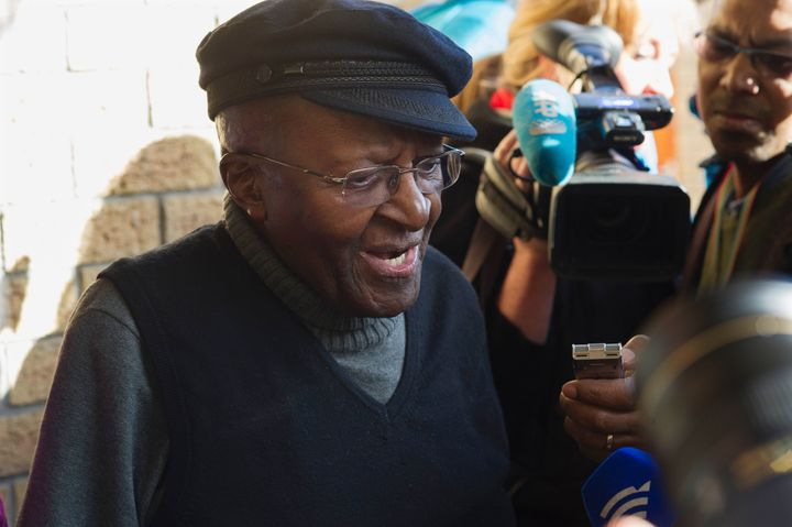 South African anti-apartheid activist and Nobel Peace Laureate Archbishop Desmond Tutu speak to journalists after casting his