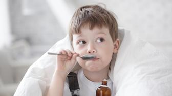 boy drinking cough syrup