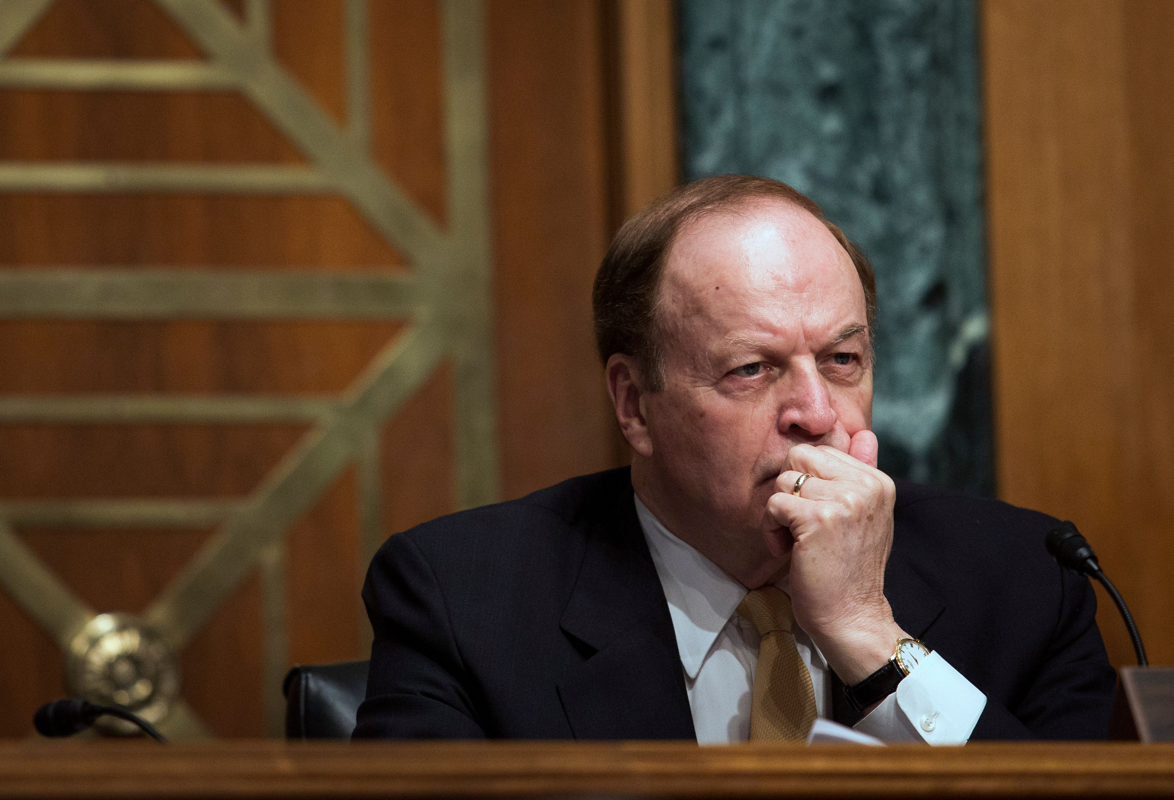 Senator Richard Shelby, a Republican from Alabama and chairman of the Senate Banking Committee, listens to the semiannual report on the economy by Federal Reserve Chair Janet Yellen in Washington, D.C., U.S., on Thursday, July 16, 2015. Yellen said the Federal Reserve is 'highly focused' on the risks of raising interest rates too early. Photographer: Drew Angerer/Bloomberg via Getty Images