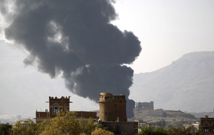 Smoke billows over the Yemeni capital of Sana'a following a reported airstrike carried out by the Saudi-led coalition.