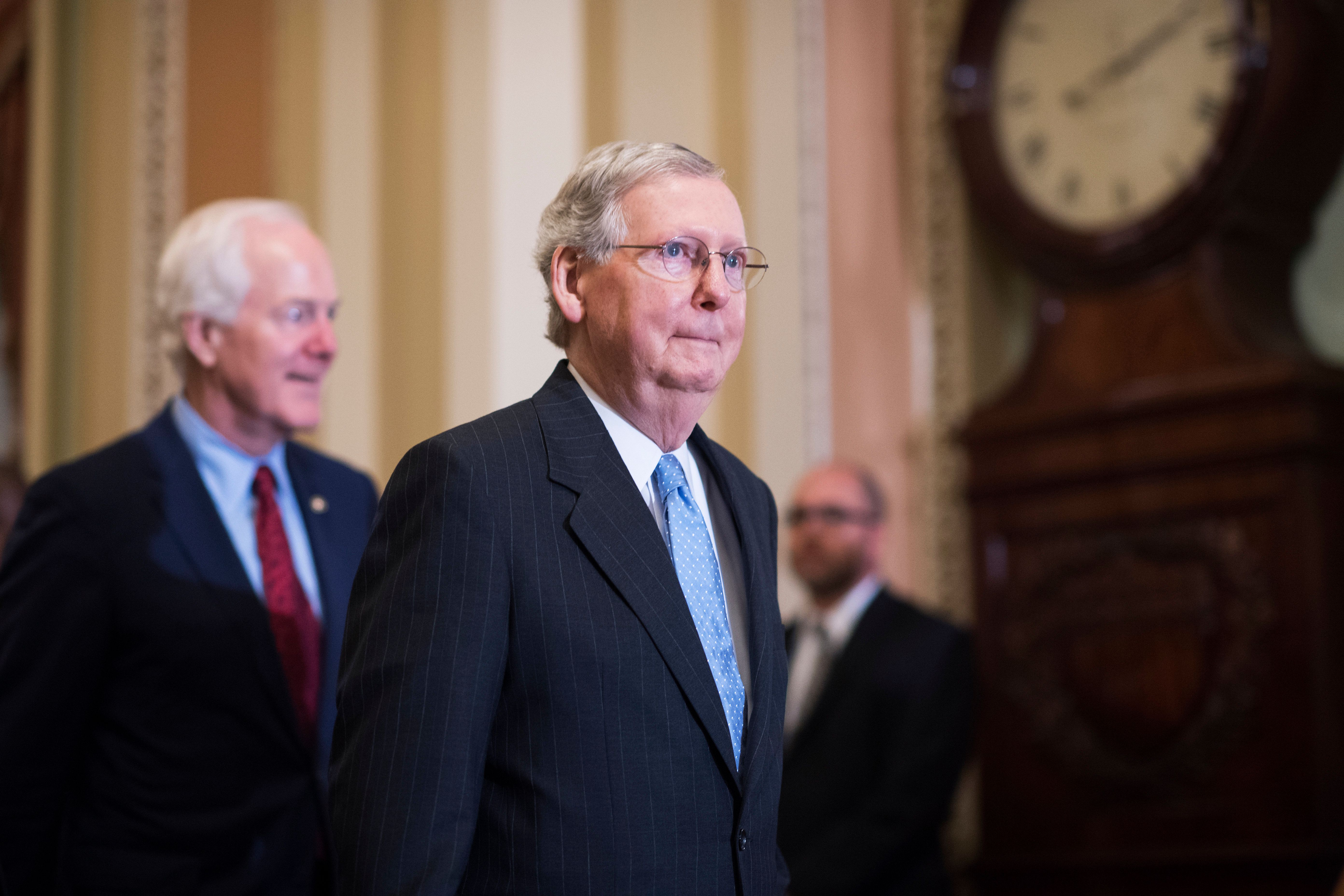 UNITED STATES - SEPTEMBER 13: Senate Majority Leader Mitch McConnell, R-Ky., right, and Senate Majority Whip John Cornyn, R-Texas, make their way to a news conference in the Capitol after the Senate Policy luncheons, September 13, 2016. (Photo By Tom Williams/CQ Roll Call)