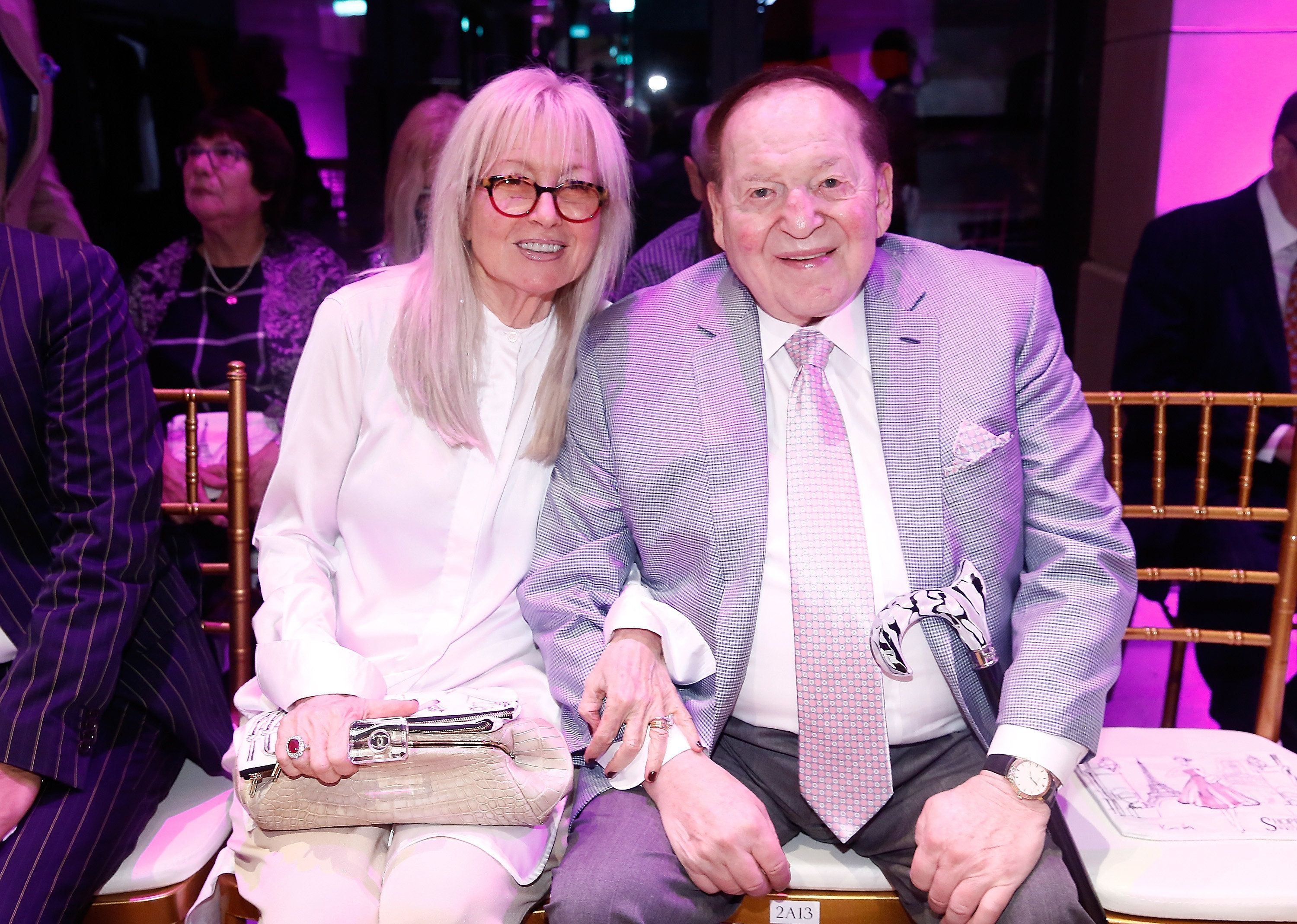 MACAU - SEPTEMBER 14:  The chairman and chief executive officer of the Las Vegas Sands Corporation Sheldon Adelson (R) and wife Miriam Adelson attend the Swarovski show during the Front Row at Shoppes at Parisian on September 14, 2016 in Macau, Macau.  (Photo by Anthony Kwan/Getty Images)