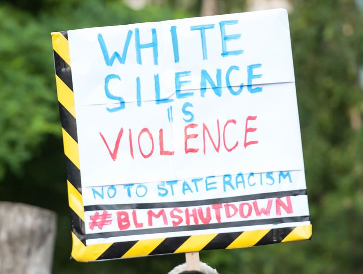 A protester at a Black Lives Matter rally holds a sign with a potent message.