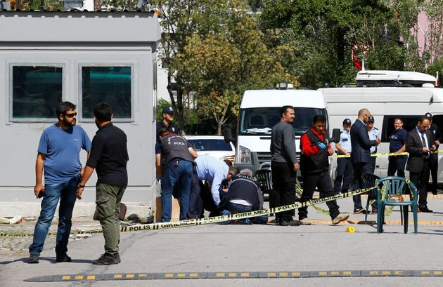 Police forensic experts examine in front of the Israeli Embassy in Ankara, Turkey, on