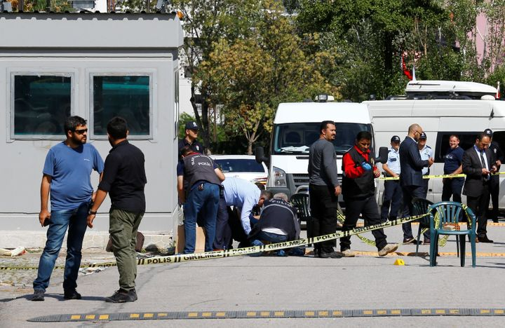 Police forensic experts examine in front of the Israeli Embassy in Ankara, Turkey, on Wednesday.
