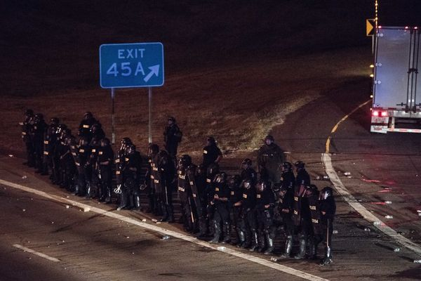 Police officers take position at an onramp on I-85.
