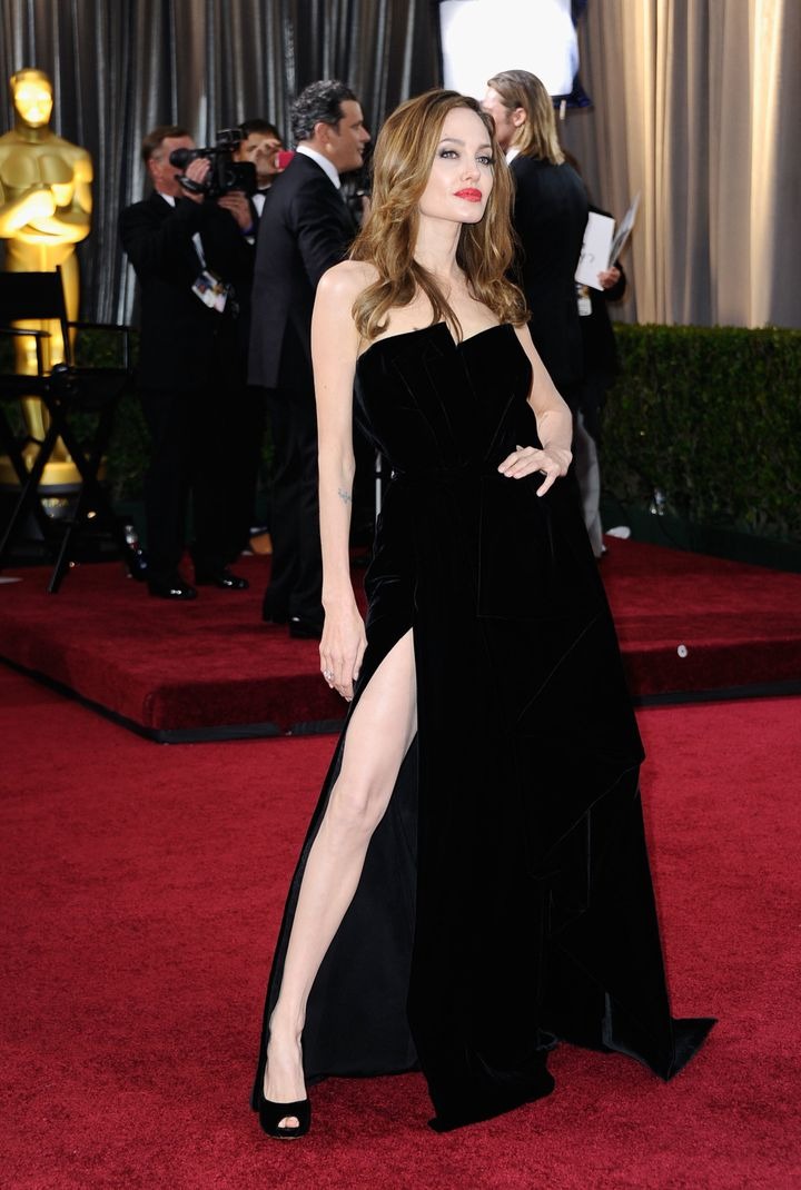 Angelina Jolie shows some leg on the Oscars red carpet.