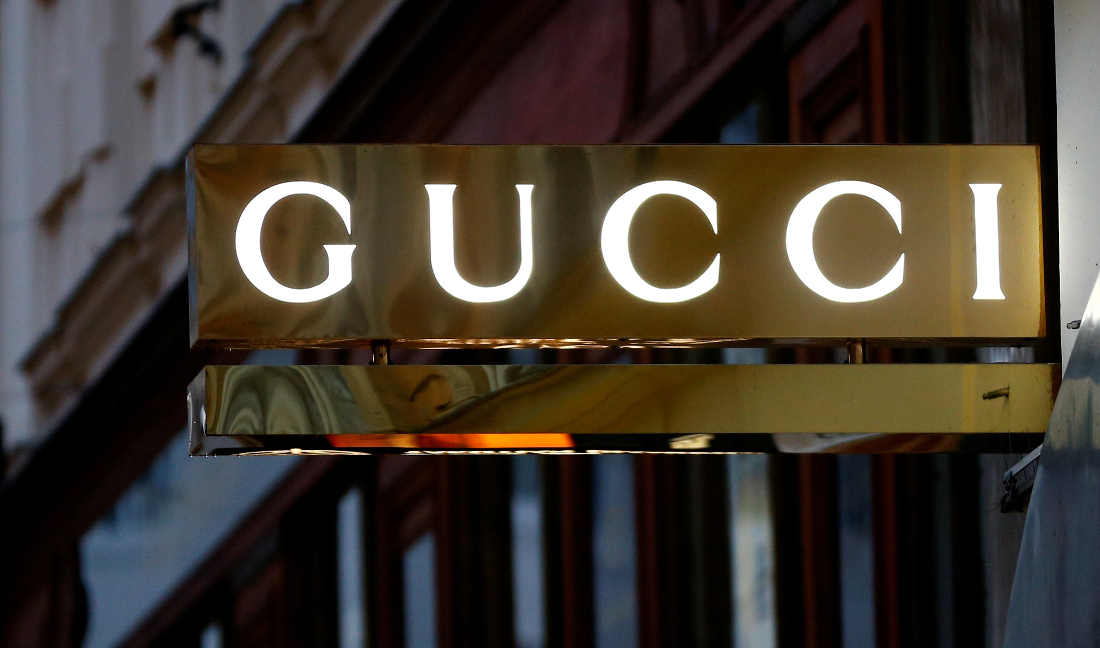 A company logo is pictured outside a Gucci store in Vienna, Austria, May 4, 2016.  REUTERS/Leonhard Foeger