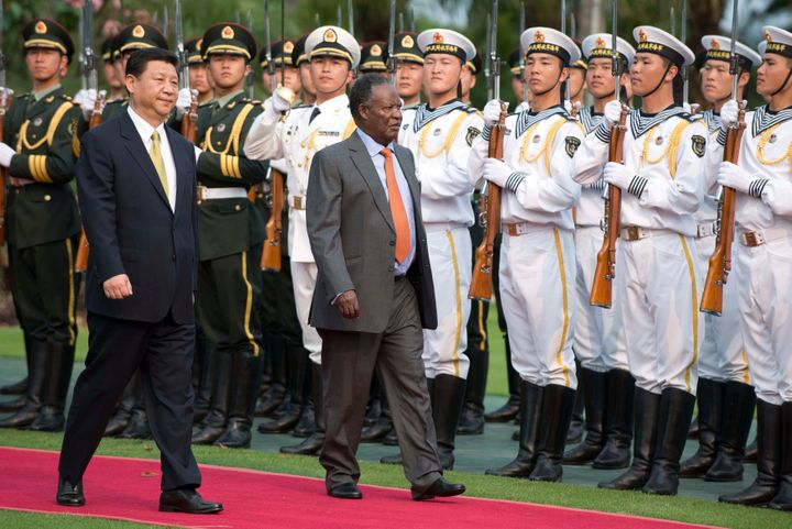 Chinese President Xi Jinping and then-Zambian President Michael Sata during a welcoming ceremony in Sanya, on the southern Ch