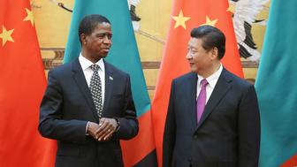 Chinese President Xi Jinping (Right) talks with Zambia's President Edgar Chagwa Lungu (Left) during a signing ceremony at the Great Hall of the People on March 30, 2015 in Beijing, China.  REUTERS/Feng Li/Pool