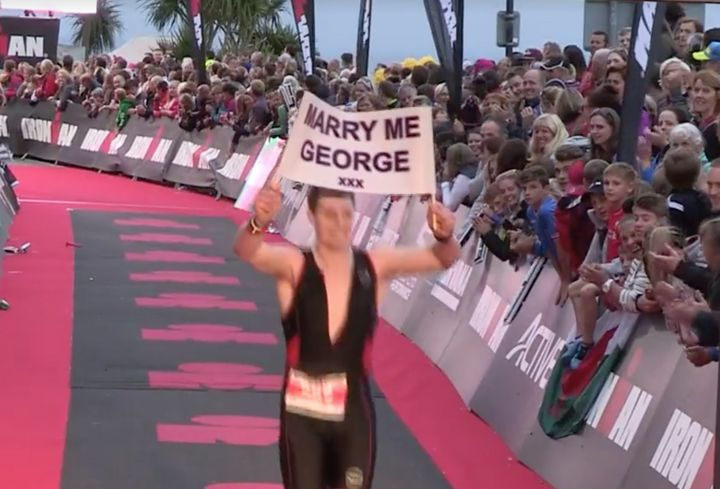 Sam crossing the line with his sign