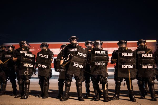 Police officers hold their line.